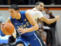 Duke's Austin Rivers steals the ball from Virginia Tech's Erick Green during the Blue Devils' 75-60 win Thursday in Blacksburg, Va.