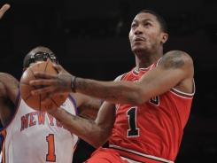 Derrick Rose (1) topped 30 points for the fourth time in five games as the Bulls edged the Knicks.