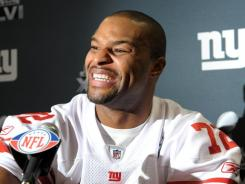Outside aggression:  Giants end Osi Umenyiora has 3 frac12/> sacks in three playoff games.