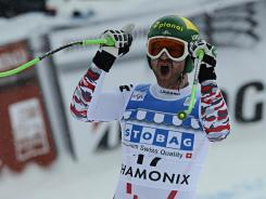 Austria's Klaus Kroell takes first place during the Audi FIS Alpine Ski World Cup men's downhill on Friday in Chamonix, France. Kroell won the event by 0.01 seconds.
