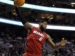 LeBron James fell two assists shy of a triple-double in Miami's sixth win in seven games.