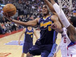 Arron Afflalo, left, chipped in 15 points off the bench to help the Nuggets snap a two-game skid.