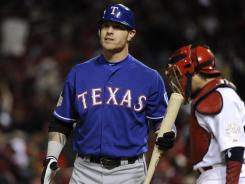 Josh Hamilton, seen here during Game 4 of the 2011 World Series, was seen drinking in a bar on Monday, according to a report. The Texas Rangers released a statement saying that the team is aware of the incident.