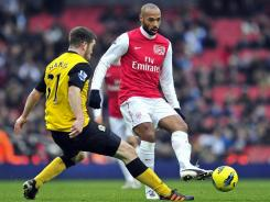 Arsenal's Thierry Henry, right, maneuvers past Blackburn's Grant Hanley during their English Premier League match Saturday.