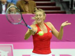 Maria Sharapova of Russia raps a forehand during her victory against Silva Soler-Espinosa of Spain.