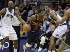 Cavaliers rookie' Kyrie Irving, center, had 20 points, including the go-ahead basket in the win over the Mavericks.