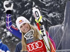 Lindsey Vonn celebrates after winning Saturday's downhill by nearly a half a second for her 50th World Cup victory.