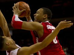 Ohio State forward Jared Sullinger shoots over Wisconsin Badgers guard-forward Ryan Evans during the second half at the Kohl Center.
