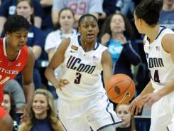 Connecticut's Tiffany Hayes passes the ball up to Bria Hartley come up with her in the second half in Storrs, Conn.