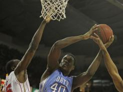 Tar Heels forward Harrison Barnes drives to the basket during North Carolina's win.