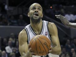 Spurs guard Tony Parker goes to the hoop against the Thunder's Nazr Mohammed during the first half of their game on Saturday. Parker had 42 points in San Antonio's win.