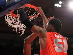 Syracuse Orange center Fab Melo scores during Saturday's first half.