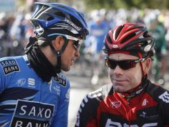 Alberto Contador (left) speaks with Cadel Evans before the start of the first stage of the Mallorca Challenge cycling race in Palma de Mallorca, Spain, on Sunday.