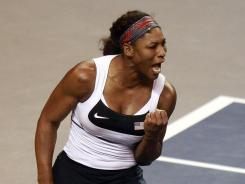 Serena Williams pumps her first in celebration on her way to a 5-7, 6-1, 6-1 victory against Anastasia Yakimova, clinching a U.S. Fed Cup win vs. Belarus.