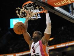 Dwayne Wade dunks the ball during the second half of the Heat's 95-89 win over the Raptors on Sunday. Wade finished with 25 points as Miami recorded its seventh win in eight games.