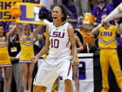 Lady Tigers guard Adrienne Webb celebrates following a win over the Wildcats.