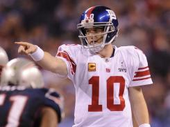 Eli Manning (10) directs the offense during Super Bowl XLVI. He led the winning drive late in the fourth quarter, taking the Giants 88 yards.