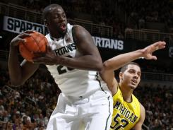 Michigan State's Draymond Green, left, pulls down a rebound in the first half of Saturday's game. Green finished the game with 16 rebounds.