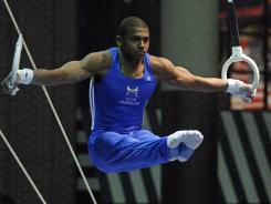 Gymnast John Orozco competes on the rings during the Winter Cup Challenge in Las Vegas.