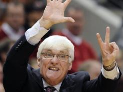 In this Dec. 20, 2011, file photo, Charleston coach Bobby Cremins signals to his players during the first half of their NCAA college basketball game against Louisville, in Louisville, Ky.