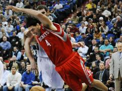 Houston Rockets forward Luis Scola is knocked to the ground in Saturday's game vs. Minnesota by Timberwolves forward Kevin Love, who later stomped on Scola's face and upper body. Monday, the NBA suspended Love for two games.