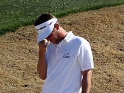 Spencer Levin shows his frustration during his final-round 4-over 75 that cost him a win Sunday in the Waste Management Phoenix Open.