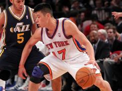 In his first career start, Jeremy Lin (17) scored a career-high 28 points to help the Knicks overcome the absence of Carmelo Anthony and Amar'e Stoudemire.