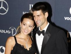 Novak Djokovic of Serbia, with girlfriend Jelena Ristic, was named Laureus World Sportsman of the Year after his dominant tennis season in 2011.