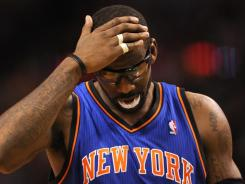 Amar'e Stoudemire, shown in Friday's game against the Celtics, was flying back to Florida after his brother was killed in a car accident.