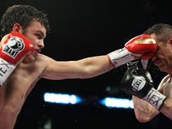 Julio Cesar Chavez, Jr., left, outslugged Marco Antonio Rubio during their middleweight title bout last weekend.