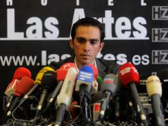 Spanish cyclist Alberto Contador speaks at a news conference Tuesday in Madrid, a day after the Court of Arbitration for Sport handed him a two-year ban and stripped him of his 2010 Tour de France title.