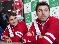 Roger Federer, left, and Stanislas Wawrinka of Switzerland speak to the media during a press conference in Fribourg, Switzerland, Tuesday.