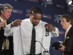 "Tigers GM Dave Dombrowski, left, here during Prince Fielder's introduction, says his ""gut reaction"" is his new first baseman will continue to swing the bat well in Detroit."