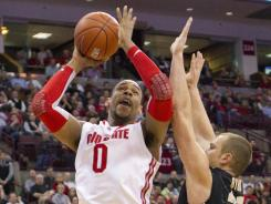 Ohio State forward Jared Sullinger (0) shoots against Purdue guard D.J. Byrd at Value City Arena.