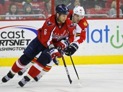 Capitals defenseman Dennis Wideman (6) skates with the puck as Panthers center Tomas Kopecky (82) chases in their matchup Tuesday night. The Washington defense kept Florida off the board despite allowing 42 shots on goal.