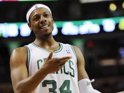 Boston forward Paul Pierce talks to an official during the fourth quarter at TD Garden. He now trails just John Havlicek on the Celtics' career scoring list.