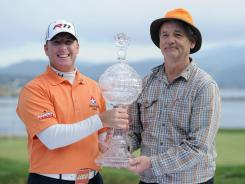 D.A. Points and Bill Murray hold the trophy after the final round of the 2011 AT&T Pebble Beach National Pro-Am.