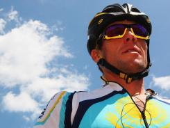 In this file photo from 2009, Lance Armstrong waits at the start of stage 19 of the 2009 Tour de France in Aubenas, France. U.S. authorities announced last week that Armstrong will not be charged after a investigation into alleged doping.