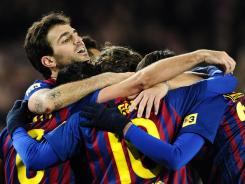 FC Barcelona's Cesc Fabregas (left) celebrates Xavi Hernandez's goal against Valencia during their Copa del Rey match at the Camp Nou Stadium in Barcelona on Wednesday.