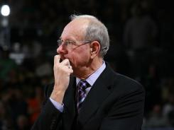 Lawyers for Syracuse University and basketball coach Jim Boeheim say two men suing them for defamation are only out to generate salacious headlines.