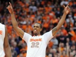 Kris Joseph celebrates his go-ahead 3-pointer that sealed Syracuse's win over rival Georgetown.
