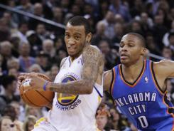 KEVIN DURANT, Thunder hold off Warriors despite Monta Ellis' 48 points