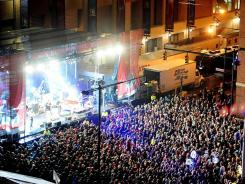Recording artist Umphries McGee plays at the Verizon Stage in Super Bowl Village in downtown Indianapolis.