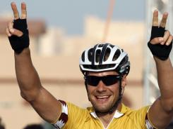 Belgian rider Tom Boonen of the Omega Pharma-Quick Step team flashes the victory sign after crossing the finish line to win the fourth stage of the Tour of Qatar on Wednesday.