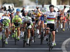 Sky Team rider Mark Cavendish of Great Britain celebrates after winning a sprint finish in the fifth stage of the Tour of Qatar on Thursday.