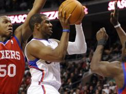 Los Angeles Clippers guard Chris Paul (3) goes up for a shot against the Philadelphia 76ers.