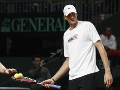 John Isner opens against Roger Federer in a Davis Cup singles match Friday.