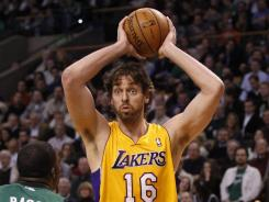 Los Angeles Lakers power forward Pau Gasol (16) looks for an open teammate against the Boston Celtics Thursday night. Gasol scored 25 points and made a critical block as time expired in OT to give the Lakers an 88-87 win in Boston.