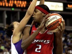 Michelle Snow, right, shown here with the Houston Comets in 2006, will be playing for her fifth WNBA team after signing with the Washington Mystics.