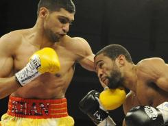 Amir Khan, left, is set for a rematch with Lamont Peterson after losing to the WBA light welterweight title in December.
